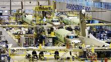 Planes on the assembly line at a Bombardier manufacturing plant in Toronto in this 2010 photo. Bombardier is a Canadian company that has adopted a much more comprehensive and multi-dimensional view of global trade and investment. (MARK BLINCH/MARK BLINCH/REUTERS)