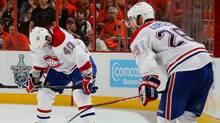 Maxim Lapierre and Josh Gorges of the Montreal Canadiens look on against the Philadelphia Flyers in Game 5 of the Eastern Conference Finals during the 2010 NHL Stanley Cup Playoffs at Wachovia Center on May 24, 2010 in Philadelphia, Pennsylvania. (Jim McIsaac/2010 Getty Images)