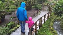 A two-year-old Metis girl walks with her foster father in Butchart Gardens in Victoria in January, 2016. (THE CANADIAN PRESS)