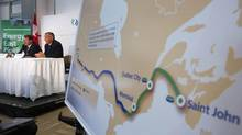 TransCanada President and CEO Russ Girling, right, discusses Energy East Pipeline in Calgary last year. (TODD KOROL/REUTERS)