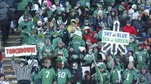 Saskatchewan Roughriders fans celebrate after a touchdown against the Calgary Stampeders during the first half of the CFL western final game in Calgary, November 17, 2013. (TODD KOROL/REUTERS)