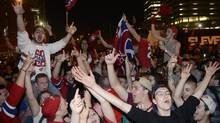 Montreal Canadiens fans celebrate their team's NHL playoff win over the Boston Bruins in Montreal on Wednesday, May 14, 2014. (THE CANADIAN PRESS)
