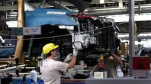 A worker assembles a Lexus RX330 at the Toyota plant in Cambridge, Ont. (Kevin Van Paassen/The Globe and Mail)