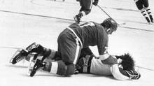 Danny Maloney of the Detroit Red Wings bangs Brian Glennie of the Toronto Maple Leafs' head against the ice after he was unconscious. Maloney was charged with assault causing bodily harm, for which he was acquitted on June 30, 1976. (John Maiola for The Globe and Mail/John Maiola for The Globe and Mail)