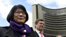 Toronto mayoral candidates Olivia Chow (LEFT) John Tory attend a flag raising ceremony at city hall on May 16 2014. (Fred Lum/Fred Lum/The Globe and Mail)