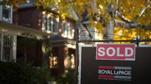 A real estate sold sign hangs in front of a west-end Toronto property on Nov. 4, 2016. (Graeme Roy/THE CANADIAN PRESS)