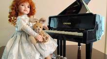 Another one of her cherished dolls she made for her sister. She found a small replica of a grand piano, but since it was wider than 12 inches, she could not submit it for competition