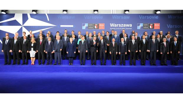 Leaders and ministers of NATO member states pose for a group photo at the PGE National Stadium in Warsaw on July 8, 2016.