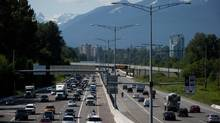 Traffic on Highway 1 near Kensington Ave. in Burnaby, B.C., on June 2, 2014. (Darryl Dyck for The Globe and Mail)