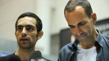 Dr. Tarek Loubani, left, and John Greyson read statements to the media after returning to Canada after being imprisoned in Egypt for over a month, on Oct. 11, 2013. (Fred Lum/The Globe and Mail)