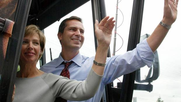 Ontario Liberal leader Dalton McGuinty and his wife Terri wave as they leave a gathering at the Vaughan-King-Aurora campaign headquaters in Toronto, Ont. Wednesday, Sept. 3, 2003. (JONATHAN HAYWARD/CP)