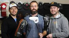 Dormie Workshop co-founders Todd, left, and Jeff Bishop and their brother Alex at their shop in Dartmouth, N.S. The company makes custom head covers for golf clubs. (Paul Darrow For The Globe and Mail)