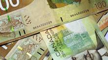 Canadian 00 bills (Peter Spiro/Getty Images/iStockphoto)