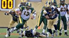 Edmonton Eskimos quarterback Mike Reilly (13) runs up field against the Winnipeg Blue Bombers during the first half of their CFL football game in Winnipeg July 17, 2014. (FRED GREENSLADE/REUTERS)