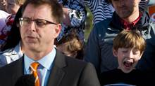 A young boy yawns as B.C. NDP Leader Adrian Dix speaks during an early morning campaign stop on Vancouver Island in Sidney, B.C., on Tuesday May 7, 2013. (DARRYL DYCK/THE CANADIAN PRESS)