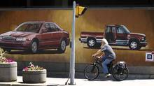 The murals on the walls of the bus station in Oshawa illustrate the importance of GM to the city. (Peter Power/The Globe and Mail)