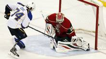 St. Louis Blues right wing T.J. Oshie scores on Minnesota Wild goalie Ilya Bryzgalov in the shootout during their NHL hockey game Sunday, March 9, 2014 in St. Paul, Minn. (Associated Press)