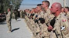 Soldiers stand at attention during Remembrance Day ceremonies in Kandahar, Afghanistan on Wednesday, Nov. 11, 2009. (Jonathan Montpetit/Copyright © The Canadian Press 2009)