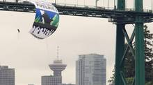 Greenpeace activists hang a large banner off the Lions Gate bridge in Vancouver, B.C. Tuesday, May 29, 2012. The banner is to protest the tar sands and the expansion of the oil pipelines. (Jonathan Hayward/The Canadian Press)