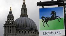 A Lloyds bank branch sign is seen near St Paul's Cathedral in London. (ANDREW WINNING/REUTERS)
