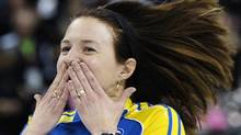 Alberta skip Heather Nedohin reacts to their win over Mantitoba during the semi-final game at the Scotties Tournament of Hearts curling championship in Red Deer, Alberta February 25, 2012. REUTERS/Todd Korol (Todd Korol/Reuters)