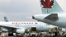 Air Canada planes are pictured at Toronto Pearson International Airport on Sunday, May 18, 2014. (Matthew Sherwood For The Globe and Mail)