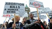Anti-abortion activists take part in the annual March For Life rally on Parliament Hill on May 10, 2012. (Sean Kilpatrick/Sean Kilpatrick/The Canadian Press)