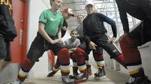 Hockey players with the Leaside Flames 2001 Minor Bantam AA team L-R: Tanner Sanford, Martins Linde, Matthew Oberfuchshuber, Wyatt Neal, Vincent Lexovsky, warmup before their game at the Hershey Centre in Mississauga, September 8, 2014. (J.P. MOCZULSKI for the globe and mail)