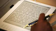 A student uses a Kindle during class at Pace University in New York in this 2009 file photo. (Mark Lennihan/The Canadian Press)