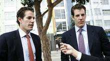 Cameron (L) and Tyler (R) Winklevoss, founders of social networking website ConnectU, speak to reporters as they leave the US Court of Appeals for the Ninth Circuit in San Francisco to attend a court hearing in a lawsuit against Facebook Inc. and its founder Mark Zuckerberg on January 11, 2011 in San Francisco. (KIMIHIRO HOSHINO/AFP/Getty Images)