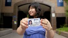 Sheery Xie poses for a photo with here expired Ryerson Student card, at Ryerson University, in Toronto, Friday, August 5, 2011. Xei uses her student card to get discounts on services like Greyhound (Brett Gundlock)