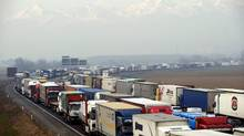 A line of trucks block a ringroad around Turin on Monday, Jan. 23, 2012. Truck drivers in Italy angered by an increase in gas prices introduced as part of the government's austerity measures have blocked highways near Milan in the north and Naples in the south. (Massimo Pinca/Massimo Pinca/Associated Press)