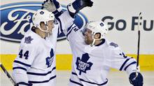 Toronto Maple Leafs defenceman Morgan Rielly (44) and winger Phil Kessel (81) celebrate a goal against the Edmonton Oilers during third period NHL hockey action in Edmonton on Tuesday, October 29, 2013. (The Canadian Press)