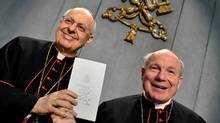 Cardinal Lorenzo Baldisseri (L) and Cardinal Christoph Schonborn hold a copy of an post-synodal apostolic new guidelines on a range of issues related to the family, on April 8, 2016 at the Vatican. (ALBERTO PIZZOLI/AFP/Getty Images)