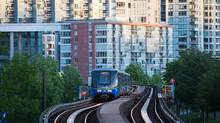 A Skytrain makes its way through downtown Vancouver in June. As home ownership becomes an impossible dream for many, having rental units close to transit is important for cost cutting. (Ben Nelms For The Globe and Mail)