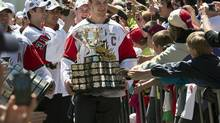 In this file photo, Halifax Mooseheads co-captain Stefan Fournier carries the Memorial Cup as the team arrives at a rally in Halifax on Tuesday, May 28, 2013. The Mooseheads defeated the Portland Winterhawks in Saskatoon to take the national major junior hockey championship. Fournier agreed to a three-year deal with the Montreal Canadiens on Saturday. (Andrew Vaughan/THE CANADIAN PRESS)
