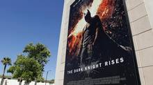 A poster for the Warner Bros. film The Dark Knight Rises is displayed at Warner Bros. studios in Burbank, California, July 20, 2012. (FRED PROUSER/REUTERS)