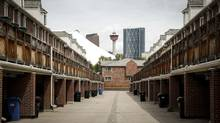 A condo complex in downtown Calgary, Alta., Thursday, June 26, 2014. (Jeff McIntosh For The Globe and Mail)