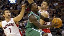 Boston Celtics guard Nate Robinson drives to the hoop through Toronto Raptors centre Andrea Bargnani (left) and forward Linas Kleiza during first half NBA action in Toronto on Friday October 15, 2010. (FRANK GUNN)