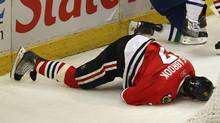 Brent Seabrook was hit behind the net in Game Three of the Western Conference Quarter-finals during the 2011 NHL Stanley Cup Playoffs at the United Center on April 17, 2011 in Chicago. (Jonathan Daniel/2011 Getty Images)