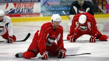 Brett Sutter, center, leads the team as players stretch during the opening hockey practice of the Charlotte Checkers training camp in Indian Trail, N.C., Saturday, Sept. 29, 2012. Several Carolina Hurricanes players are training with the Checkers, their AHL affiliate team, during the NHL lockout. (Chuck Burton/AP)