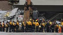 A second body recovered by search and rescue workers is carried out of the of the Algo Centre Mall in Elliot Lake, Ont. on June 27 2012. (FRED LUM/THE GLOBE AND MAIL)