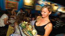 Server Izabela Lewandowsk will debone your fish tableside, if you ask her. (Peter Power/The Globe and Mail)