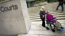 Gloria Taylor with her younger sister Patty Ferguson outside the BC supreme in Vancouver December 1, 2011 where she she is heading to court to seeking the legal right to die with dignity. (JOHN LEHMANN/The Globe and Mail)
