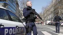 Police outside the International Monetary Fund offices where an envelope exploded in Paris on March 16, 2017. (PHILIPPE WOJAZER/REUTERS)