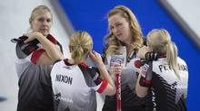 Canada's skip Chelsea Carey, centre speaks with her team, third Amy Nixon, second Jocelyn Peterman and lead Laine Peters during the 3rd draw against Switzerland at the Women's World Curling Championship in Swift Current, Sask. Sunday, March 20, 2016. (JONATHAN HAYWARD/THE CANADIAN PRESS)