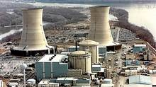 This undated US Department of Energy file photo shows two containment buildings (center) and two of the cooling towers (background) at the Three Mile Island Nuclear Power Plant in Pennsylvania. (AFP/AFP)