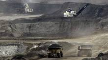 The oil sands will see carbon output rise by 62 megatonnes, tripling its 2005 levels, according to an Environment Canada forecast. (Jeff McIntosh/Associated Press/Jeff McIntosh/Associated Press)