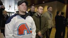 Dave Edward, a Quebec Nordiques fan, stands with others at a press conference with Quebec City mayor Regis Labeaume to announce his engagement to build a new arena, potential home for a new NHL team, Friday, Oct.16, 2009 in Quebec City. (Jacques Boissinot/The Canadian Press)