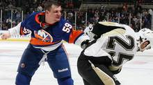 Michael Haley #59 of the New York Islanders fights Maxime Talbot #25 of the Pittsburgh Penguins in the third period on February 11, 2011 at Nassau Coliseum in Uniondale, New York. (Photo by Jim McIsaac/Getty Images) (Jim McIsaac/2011 Getty Images)